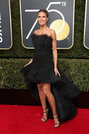 Heidi Klum got dolled up in an Ashi Studio Couture strapless dress with a feathered neckline and a high-low hem for the 2018 Golden Globes.