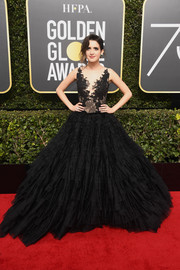 Laura Marano turned heads in a black Rita Vinieris Couture gown with a fitted lace bodice and a voluminous tiered skirt at the 2018 Golden Globes.