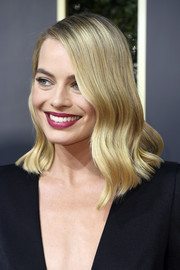 Margot Robbie finished off her look with a swipe of berry lipstick.