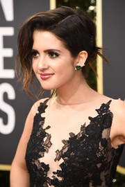 Laura Marano styled her hair into a loose updo with wavy tendrils for the 2018 Golden Globes.