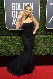 Mariah Carey looked pageant-ready in a ruched black mermaid gown by Dolce & Gabbana at the 2018 Golden Globes.