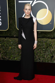 Saoirse Ronan went for futuristic glamour in a one-sleeve black and silver gown by Atelier Versace at the 2018 Golden Globes.