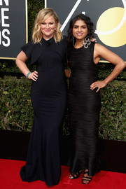 Amy Poehler chose a black Greta Constantine mermaid gown with bolero detailing for her 2018 Golden Globes look.