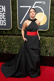 Mandy Moore made a regal entrance in a black Rosie Assoulin halter gown with a red waistband at the 2018 Golden Globes.