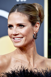Heidi Klum gathered her tresses into a big bun for the 2018 Golden Globes.
