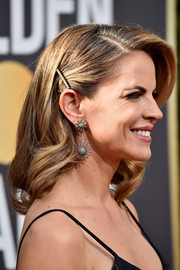 Natalie Morales accessorized with a pair of playfully glam sunburst earrings.
