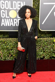 Susan Kelechi Watson completed her ensemble with a faceted silver clutch.