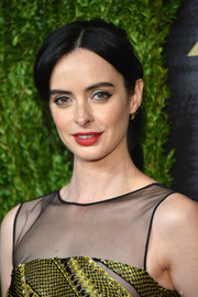 Krysten Ritter kept it simple yet chic with this center-parted ponytail at the Peabody Awards.
