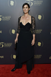 Carrie-Anne Moss turned heads at the Peabody Awards in a cleavage-baring black corset dress with lace sleeves.