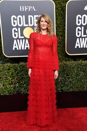 Laura Dern chose a petal-embellished red gown by Valentino for her 2019 Golden Globes look.