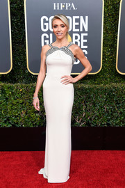 Giuliana Rancic cut a svelte silhouette in a white Gucci column dress with a beaded neckline at the 2019 Golden Globes.