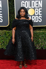 Octavia Spencer opted for a tea-length off-the-shoulder dress by Christian Siriano when she attended the 2019 Golden Globes.