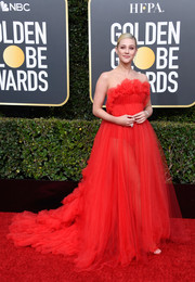 Lili Reinhart looked princess-y in a strapless red tulle gown by Khyeli Couture that she paired with Louison Pierced Swarovski earrings at the 2019 Golden Globes.