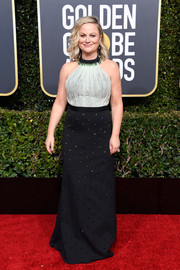 Amy Poehler cut a stylish figure in a black-and-white halter gown with green beading at the 2019 Golden Globes.