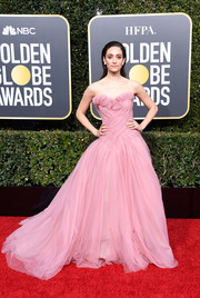 Emmy Rossum looked breathtaking in a strapless pink ball gown by Monique Lhuillier at the 2019 Golden Globes.