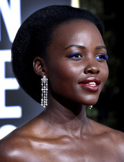 Lupita Nyong'o styled her tresses into a beehive-like updo for the 2019 Golden Globes.