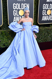 Lady Gaga was the queen of the night in a baby-blue off-the-shoulder ball gown by Valentino Couture at the 2019 Golden Globes.