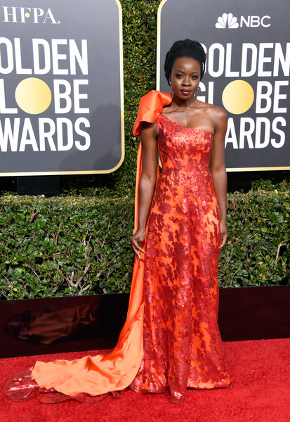 Danai Gurira was on fire in a red and orange one-shoulder gown by Rodarte at the 2018 Golden Globes.