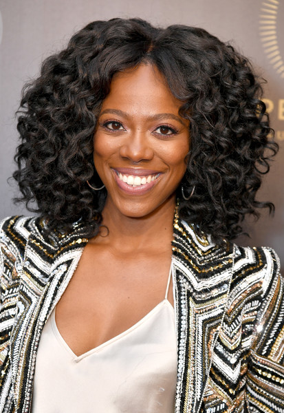 Yvonne Orji was gorgeously coiffed with voluminous curls at the 2018 Peabody Awards.