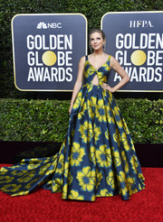 Taylor Swift was all about whimsical glamour at the 2020 Golden Globes in an Etro ballgown with an oversized floral print and a bodice cutout.