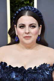 Beanie Feldstein accentuated her eyes with thick winged liner.