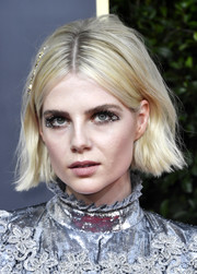 Lucy Boynton sported glittered lids for a playful beauty look.