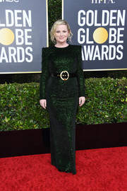 Amy Poehler got glam in a micro-beaded green column dress by Sergio Hudson for the 2020 Golden Globes.