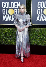 Lucy Boynton matched her dress with a pair of silver platform sandals, also by Louis Vuitton.
