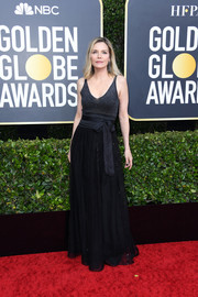Michelle Pfeiffer donned a black Brunello Cucinelli gown with a bowed waist for the 2020 Golden Globes.