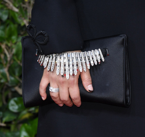 Awkwafina went for major sparkle, pairing a Forevermark diamond ring with a bejeweled clutch at the 2020 Golden Globes.