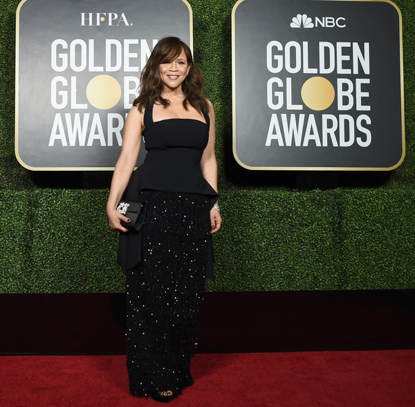 Rosie Perez donned a black Christian Siriano halter gown with a sparkling fringe skirt for the 2021 Golden Globe Awards.
