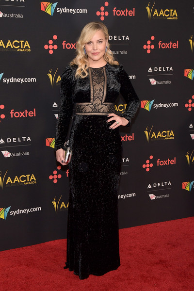 Abbie Cornish went for goth glamour in a black Tadashi Shoji velvet gown with a lace-panel bodice at the AACTA International Awards.