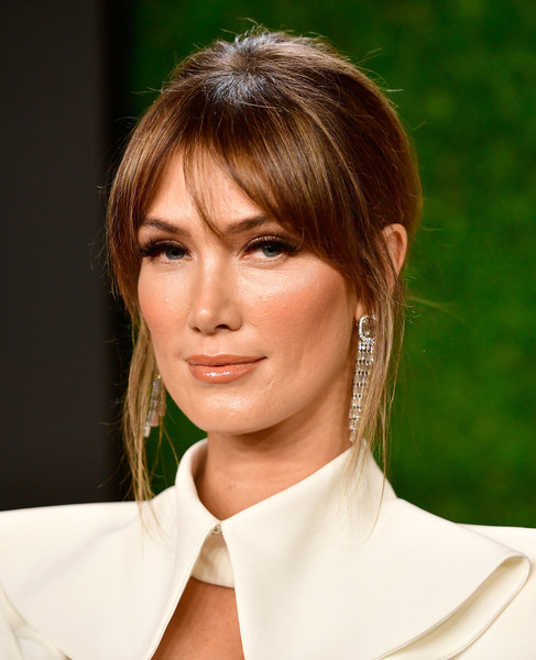 Delta Goodrem styled her hair into a chignon with parted bangs for the AACTA International Awards.