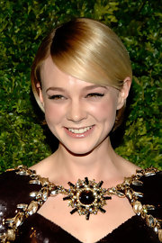Carey Mulligan showed off her side swiped cropped 'do which looked oh so chic when paired with her Chanel Couture ensemble.