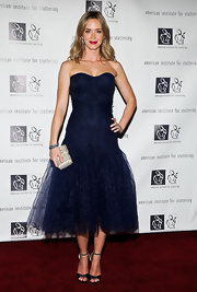 Emily Blunt wore a deep midnight blue strapless dress with a fitted bustier top and full tulle skirt to the 'Freeing Voices, Changing Lives' benefit gala.