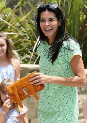 Angie Harmon attended the Kidstock Music and Art Festival carrying a stylish rust-colored snakeskin clutch.