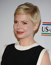 Michelle Williams wore her newly lightened tresses in a shiny, polished pixie cut at the 7th Annual pre-Academy Awards Party.