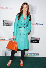 Dana Delany brought a hefty dose of tangerine, the color of the season, into her look with an orange leather tote and matching sandals.
