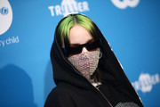 Billie Eilish looked cool with her rectangular shades and green hair at the 2019 UNICEF Masquerade Ball.