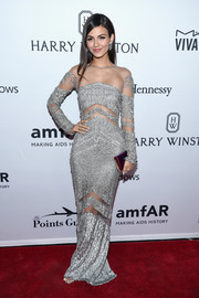 Victoria Justice made an ultra-glam statement in this heavily beaded sheer-panel gown by Pamella Roland at the amfAR Inspiration Gala.