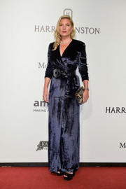 Kate Moss kept it classy in a midnight-blue velvet wrap gown at the amfAR Inspiration Gala Sao Paulo.