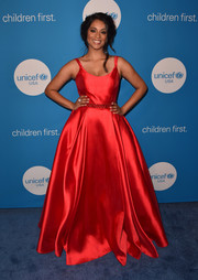 Lilly Singh stunned in a gorgeous red princess gown at the 2018 UNICEF Ball.