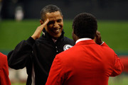 U.S. President Barack Obama salutes hall of famer Lou Brock after throwing out the first pitch at the 2009 MLB All-Star Game at Busch Stadium on July 14, 2009 in St Louis, Missouri.