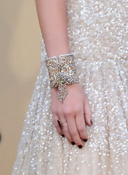 Miley Cyrus wore some serious arm candy to the Academy Awards. Her diamond embellished bracelet really stood out amongst the crowd.