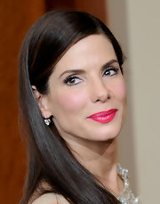 Sandra Bullock topped off her winning 2010 Oscars look with a bright pink pout.