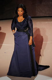 Oprah Winfrey showed off her navy evening dress while attending the Annual Academy Awards.