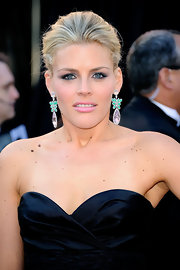 Busy Philipps paired strapless midnight gown with dangling pendant earrings.