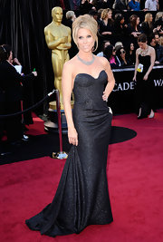 Cheryl looked luxe at the Academy Awards in a sparkling strapless corset silver-flecked black wool gown.