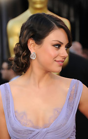 Mila Kunis paired her stunning lilac Elie Saab gown with soft pinned up ringlets.