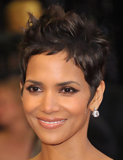 Halle Berry added a sparkling touch to her look with large diamond drop earrings.